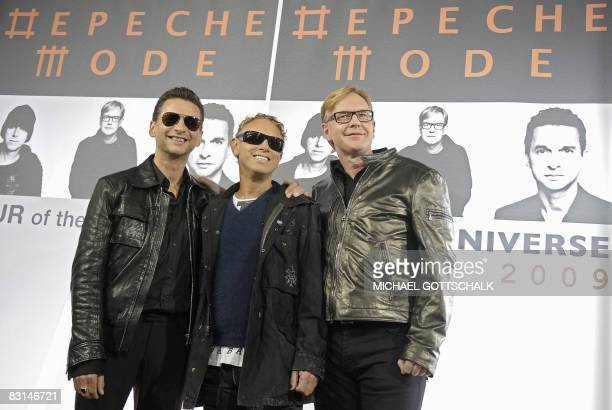 Musicians David Gahan Martin Gore and Andrew Fletcher of British group Depeche Mode pose on October 6 2008 at the Olympic stadium in Berlin during a...