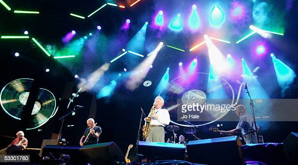 Musicians David Gilmour Richard Wright and Roger Waters from the band Pink Floyd perform on stage at 'Live 8 London' in Hyde Park on July 2 2005 in...