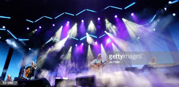 Musicians David Gilmour Roger Waters and Richard Wright from the band Pink Floyd perform on stage at 'Live 8 London' in Hyde Park on July 2 2005 in...