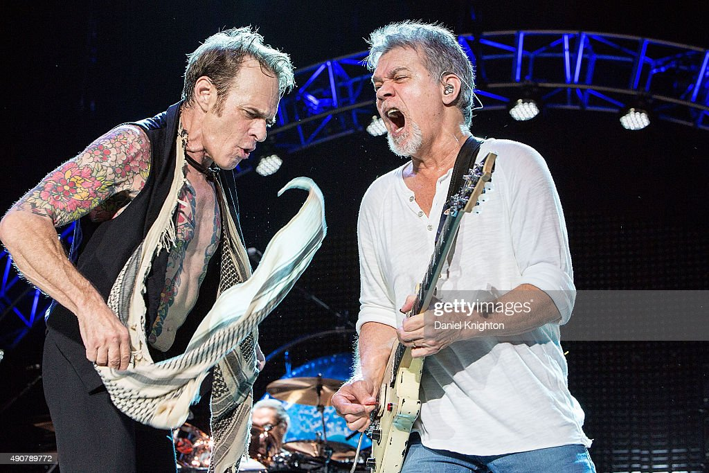Musicians David Lee Roth (L) and Eddie Van Halen of Van Halen perform on stage at Sleep Train Amphitheatre on September 30, 2015 in Chula Vista, California.