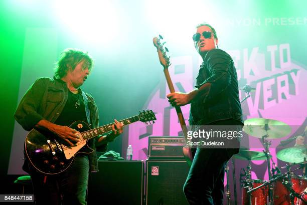 Musicians Dean DeLeo and Robert DeLeo of Stone Temple Pilots perform onstage during the second annual Rock for Recovery benefit concert at The Fonda...