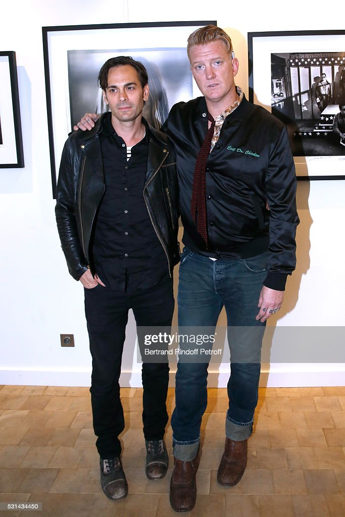 Musicians Dean Fertita and Josh Homme attend Iggy Pop 'Post Depression' Art Pictures Exhibition at French Paper Gallery on May 14, 2016 in Paris, France.