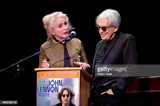 Musicians Debbie Harry and Chris Stein of Blondie speak onstage during the 34th Annual John Lennon Tribute Benefit Concert at Symphony Space on...