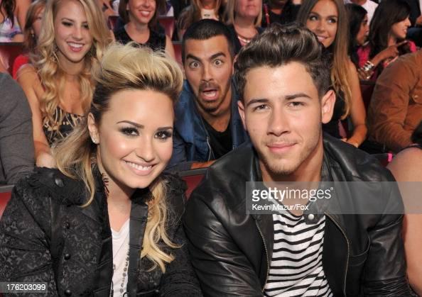 Musicians Demi Lovato Joe Jonas and Nick Jonas attend the 2013 Teen Choice Awards at Gibson Amphitheatre on August 11 2013 in Universal City...