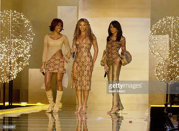 Musicians Destiny's Child prepare to perform at the Victoria Secret Fashion Show at the Lexington Avenue Armory November 14 2002 in New York City New...