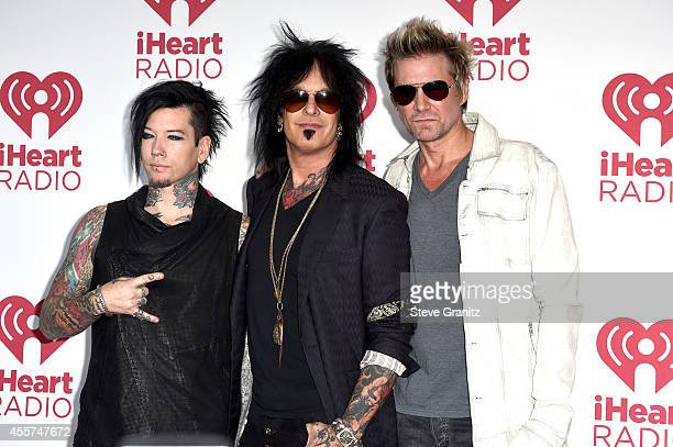 Musicians DJ Ashba Nikki Sixx and James Michael of SixxAM attend night 1 of the 2014 iHeartRadio Music Festival at MGM Grand Garden Arena on...
