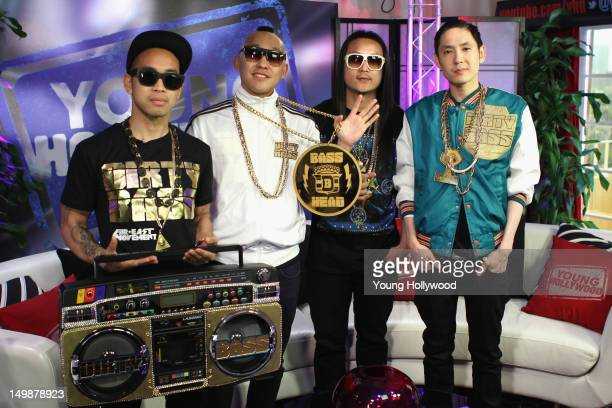 Musicians DJ Virman Prohgress JSplif and Kev Nish of the band Far East Movement visit the Young Hollywood Studio on July 31 2012 in Los Angeles...