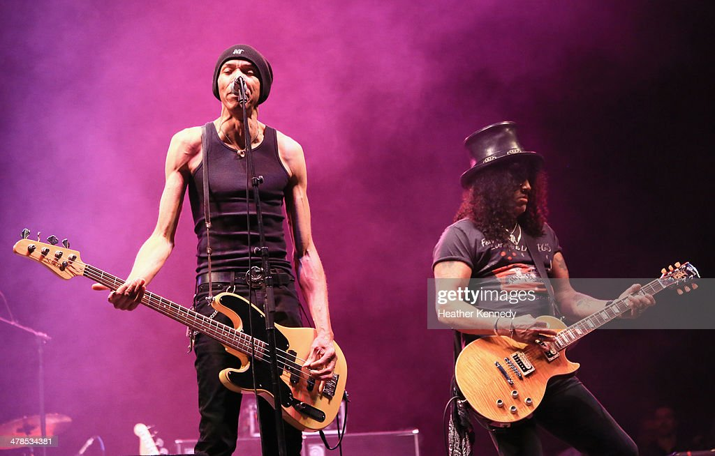 Musicians Doug Pinnick and Slash perform onstage during the USPS Hendrix Stamp Event + Los Lonely Boys during the 2014 SXSW Music, Film + Interactive at Butler Park on March 13, 2014 in Austin, Texas.