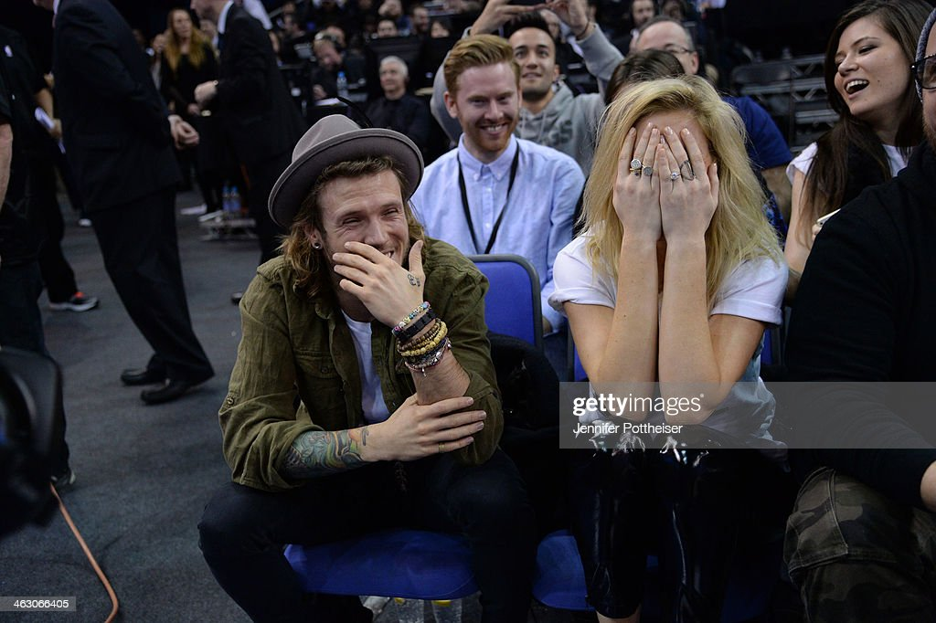 Musicians <a gi-track='captionPersonalityLinkClicked' href=/galleries/search?phrase=Dougie+Poynter&family=editorial&specificpeople=214057 ng-click='$event.stopPropagation()'>Dougie Poynter</a> and <a gi-track='captionPersonalityLinkClicked' href=/galleries/search?phrase=Ellie+Goulding&family=editorial&specificpeople=6389309 ng-click='$event.stopPropagation()'>Ellie Goulding</a> takes in the game of the Brooklyn Nets against the Atlanta Hawks as part of the 2014 Global Games on January 16, 2014 at The O2 Arena in London, England.