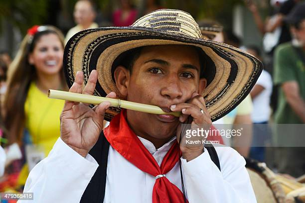 BARRANQUILLA COLOMBIA JANUARY 26 2014 Musicians dressed in white participate in the procession of Children's Carnival on January 26 2014 in...