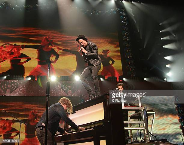 Musicians Drew Brown and Ryan Tedder of OneRepublic perform onstage at the Q102's Jingle Ball 2014 at Wells Fargo Center on December 10 2014 in...