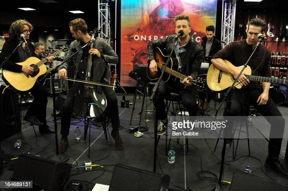 Musicians Drew Brown Brent Kutzle Ryan Tedder and Zach Filkins of OneRepublic promote 'Native' at Best Buy on March 26 2013 in New York City