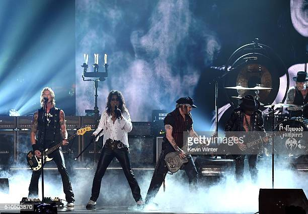 Musicians Duff McKagan Alice Cooper Johnny Depp Joe Perry and Matt Sorum of music group The Hollywood Vampires perform onstage during The 58th GRAMMY...
