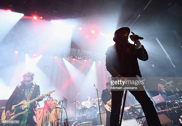 Musicians Earl Slick and Bernard Fowler perform during the 'Celebrating David Bowie A Very Special David Bowie Concert With Bowie People Playing...
