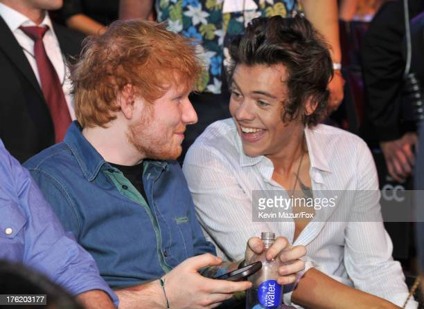 Musicians Ed Sheeran and Harry Styles of One Direction attend the 2013 Teen Choice Awards at Gibson Amphitheatre on August 11 2013 in Universal City...