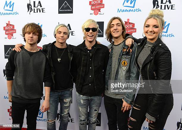 Musicians Ellington Ratliff Ross Lynch Riker Lynch Rocky Lynch and Rydel Lynch of the band R5 pose on the red carpet at LA LIVE on December 6 2014 in...