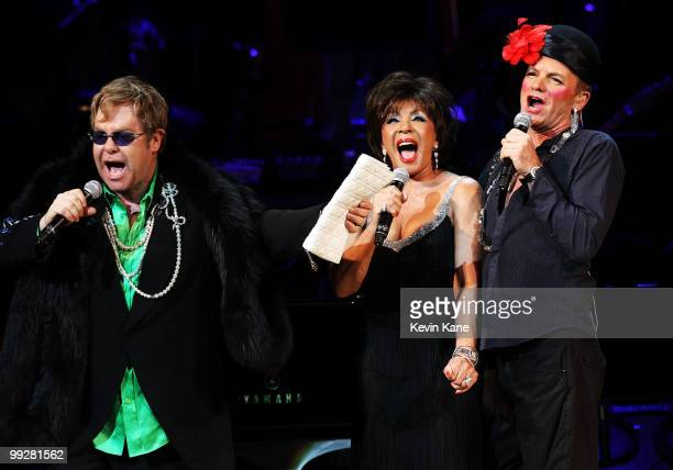 Musicians Elton John Dame Shirley Bassey and Sting perform on stage during the Almay concert to celebrate the Rainforest Fund's 21st birthday at...