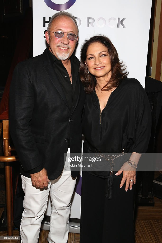 Musicians Emilio Estefan and Gloria Estefan pose at the Get On Your Feet panel during Advertising Week 2015 AWXII at the Hard Rock Cafe New York on...
