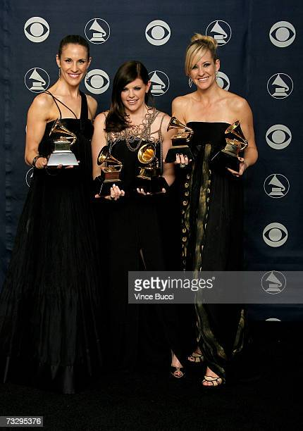Musicians Emily Robinson Natalie Maines and Martie Maguire of the group The Dixie Chicks poses with their Grammy's for Record of the Year Album of...