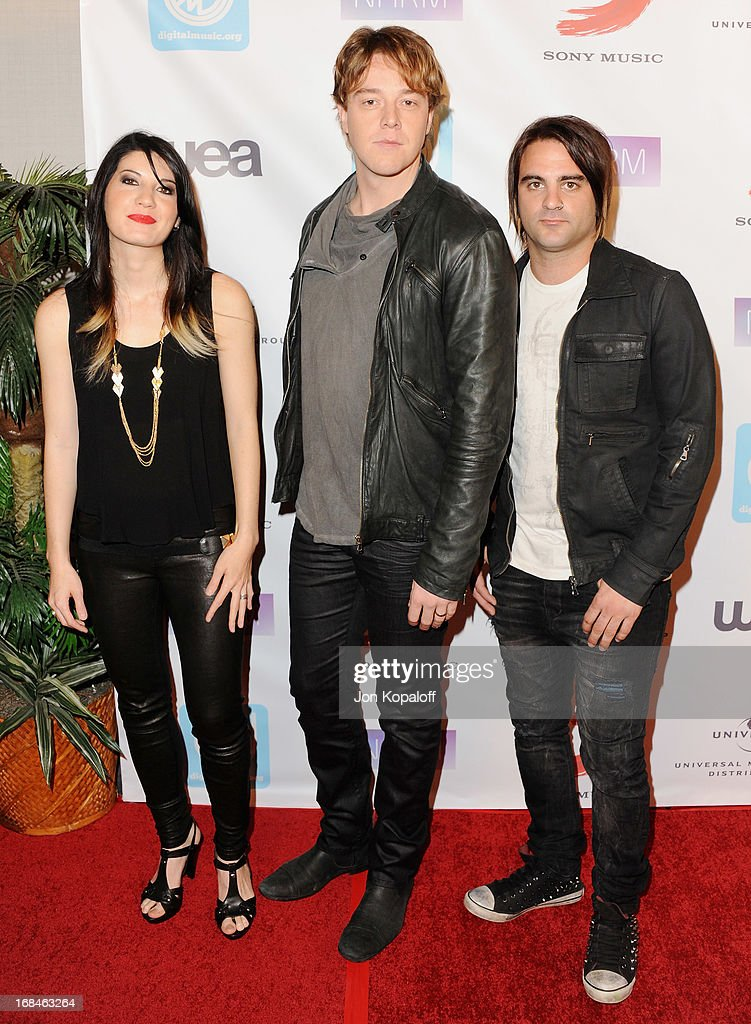 Musicians Emma Anzai, Shimon Moore and Mark Goodwin of Sick Puppies arrive at the NARM Music Biz 2013 Awards Dinner Party at the Hyatt Regency Century Plaza on May 9, 2013 in Century City, California.