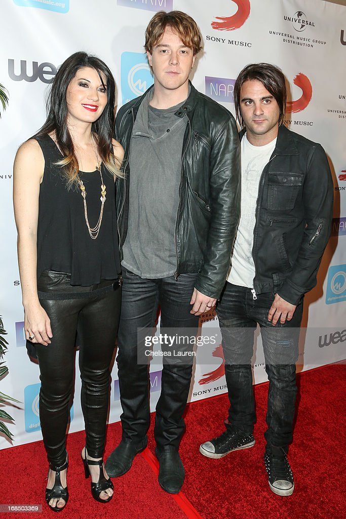 Musicians Emma Anzai, Shimon Moore and Mark Goodwin of Sick Puppies attend at the NARM Music Biz Awards dinner party at the Hyatt Regency Century Plaza on May 9, 2013 in Century City, California.