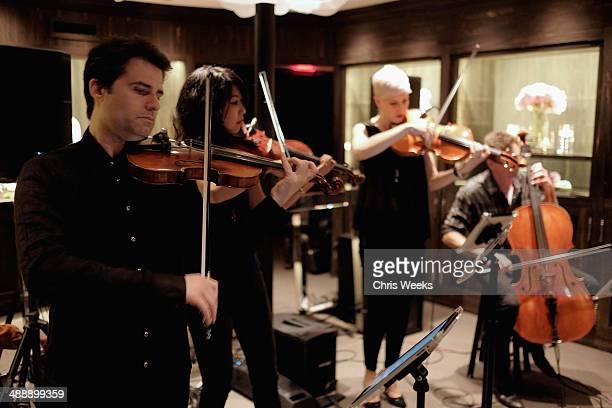 Musicians Eric Gorfain Daphne Chen Lauren Chipman and Richard Dodd of The Section Quartet perform at Chrome Hearts Kate Hudson Host Garden Party To...