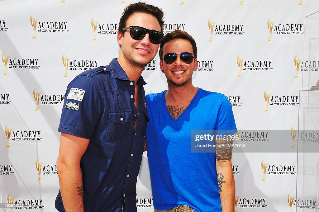 Musicians Eric Gunderson and Steven Barker Liles of the band Love and Theft attend The ACM Experience during the 48th Annual Academy of Country Music Awards at the Orleans Arena on April 6, 2013 in Las Vegas, Nevada.