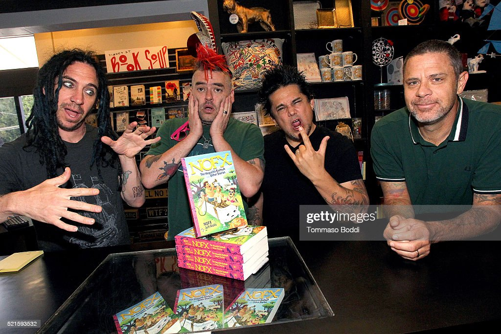Musicians Eric Melvin Fat Mike El Hefe and Erik Sandin pose during the NOFX book signing for 'NOFX The Hepatitis Bathtub And Other Stories' at Book...