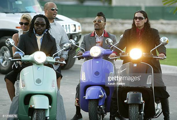 Musicians Fergie WillIAm ApldeAp and Taboo of the band The Black Eyed Peas arrive at the 2004 MTV Video Music Awards at the American Airlines Arena...