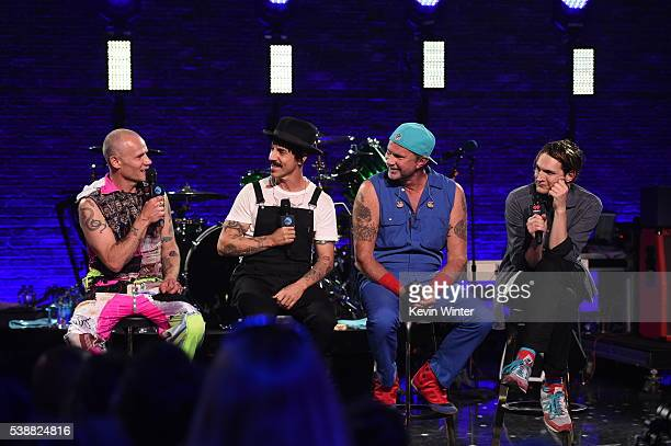 Musicians Flea Anthony Kiedis Chad Smith and Josh Klinghoffer of Red Hot Chili Peppers speak onstage during their album release party on ATT LIVE at...