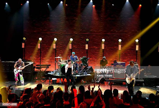 Musicians Flea Anthony Kiedis Chad Smith and Josh Klinghoffer of Red Hot Chili Peppers perform onstage during their album release party on ATT LIVE...
