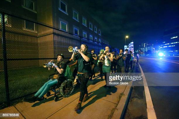 Musicians from eight bands in Boston for the HONK Festival march to the Suffolk County House of Correction in Boston which provides space for a...