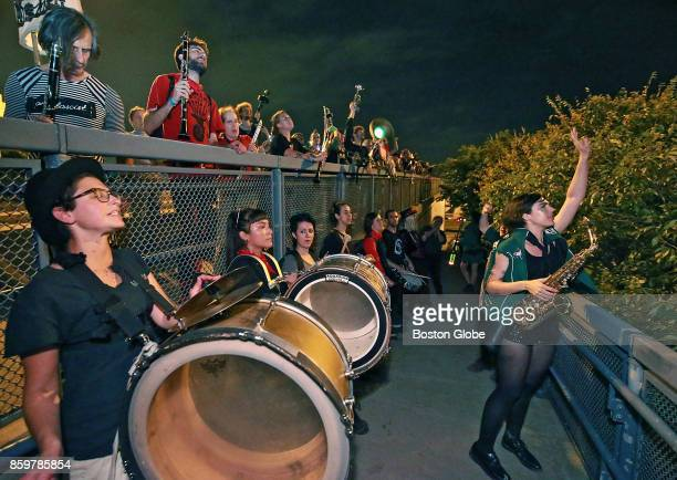 Musicians from eight bands in Boston for the HONK Festival perform outside the Suffolk County House of Correction in Boston which provides space for...