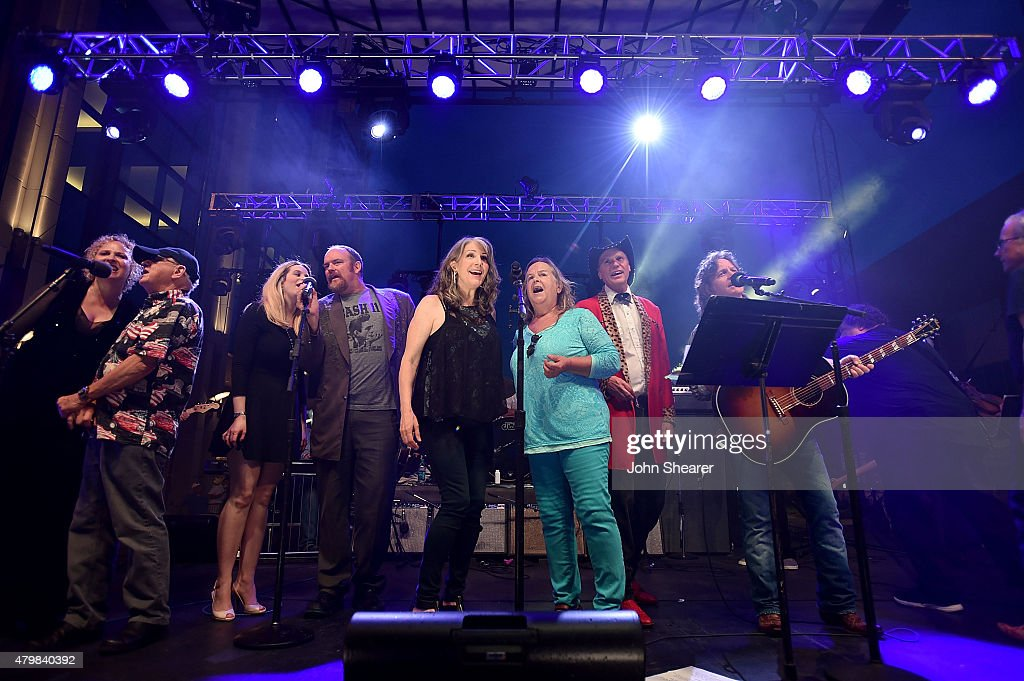 Musicians from left Julie Christensen Charlie McCoy Ana Cristina John Carter Cash Kathy Mattea Tracy Nelson Jason Ringenberg and Jeff Hanna perform...