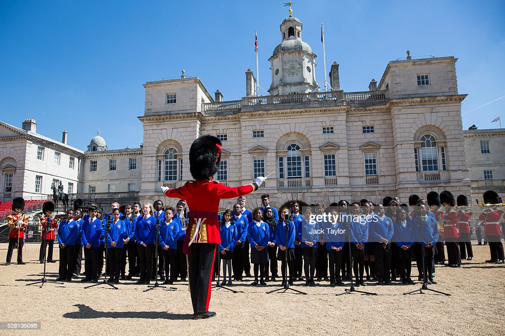 Musicians from the Household Division and members of the Commonwealth Children's Choir take part in an Act of Reverence featuring a set of 100-year-old bagpipes at Horse Guards Parade on May 4, 2016 in London, England. The bagpipes belonged to a Pipe Major of the Regiment of the Argyll and Sutherland Highlanders who died after becoming ill in the trenches at the Battle of the Somme. The bagpipes were brought to Horse Guards Parade today for a performance to launch the Household Division's Beating Retreat concerts, which feature military drills, music and fireworks, taking place on the 8th and 9th of June.