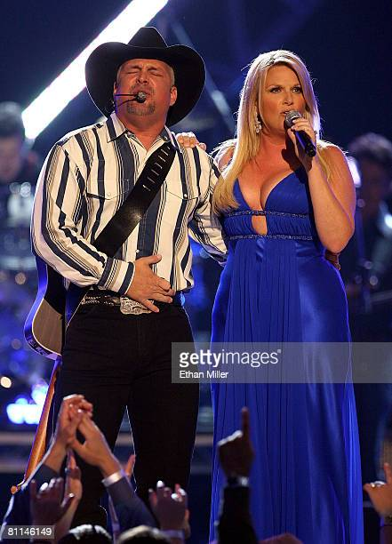 Musicians Garth Brooks and wife Trisha Yearwood perform onstage during the 43rd annual Academy Of Country Music Awards held at the MGM Grand Garden...
