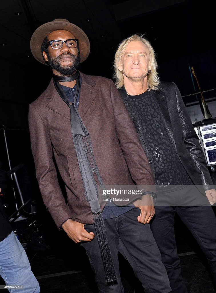 Musicians Gary Clark Jr. (L) and Joe Walsh pose backstage at 'The Night That Changed America: A GRAMMY Salute To The Beatles' at the Los Angeles Convention Center on January 27, 2014 in Los Angeles, California.