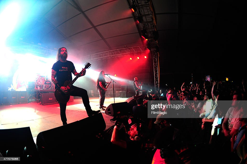 Musicians <a gi-track='captionPersonalityLinkClicked' href=/galleries/search?phrase=Gary+Holt+-+Musician&family=editorial&specificpeople=15005307 ng-click='$event.stopPropagation()'>Gary Holt</a>, <a gi-track='captionPersonalityLinkClicked' href=/galleries/search?phrase=Tom+Araya&family=editorial&specificpeople=235893 ng-click='$event.stopPropagation()'>Tom Araya</a>, and <a gi-track='captionPersonalityLinkClicked' href=/galleries/search?phrase=Kerry+King&family=editorial&specificpeople=236089 ng-click='$event.stopPropagation()'>Kerry King</a> of Slayer perform onstage at This Tent during Day 3 of the 2015 Bonnaroo Music And Arts Festival on June 13, 2015 in Manchester, Tennessee.