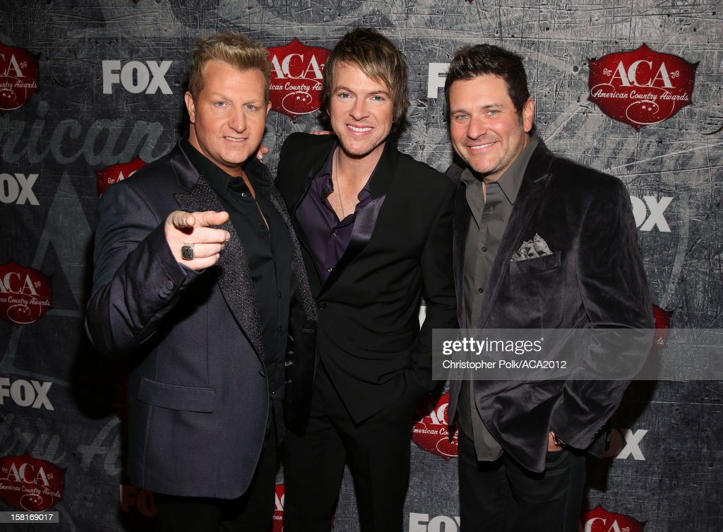 Musicians Gary LeVox, <a gi-track='captionPersonalityLinkClicked' href=/galleries/search?phrase=Joe+Don+Rooney&family=editorial&specificpeople=241526 ng-click='$event.stopPropagation()'>Joe Don Rooney</a> and <a gi-track='captionPersonalityLinkClicked' href=/galleries/search?phrase=Jay+DeMarcus&family=editorial&specificpeople=224578 ng-click='$event.stopPropagation()'>Jay DeMarcus</a> of Rascal Flatts arrive at the 2012 American Country Awards at the Mandalay Bay Events Center on December 10, 2012 in Las Vegas, Nevada.