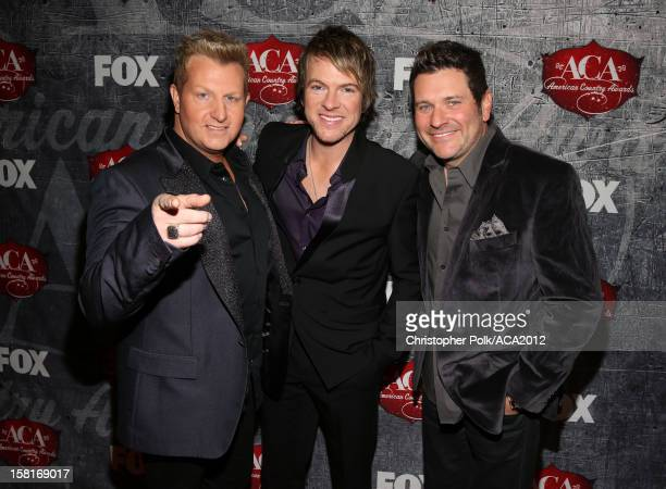 Musicians Gary LeVox Joe Don Rooney and Jay DeMarcus of Rascal Flatts arrive at the 2012 American Country Awards at the Mandalay Bay Events Center on...