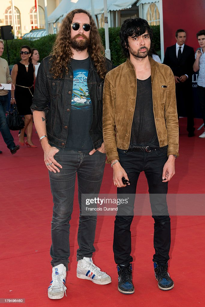 Musicians Gaspard Auge (L) and Xavier de Rosnay from the music group 'Justice' arrive at the premiere of the film 'Parkland' during the 39th Deauville American Film Festival on September 4, 2013 in Deauville, France.