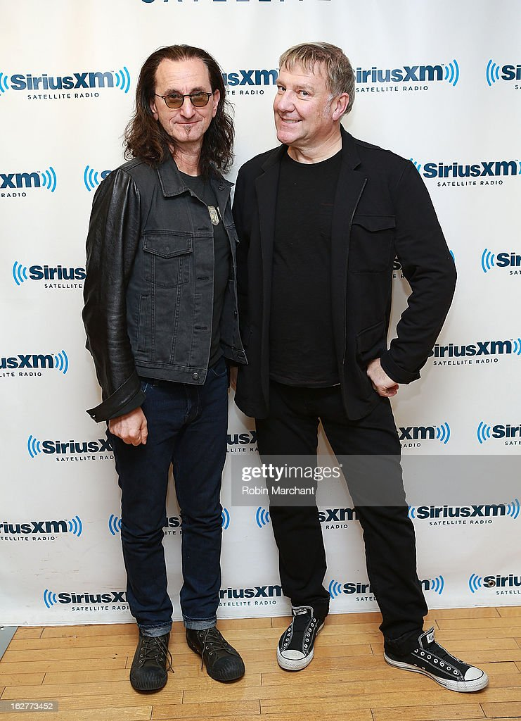 Musicians <a gi-track='captionPersonalityLinkClicked' href=/galleries/search?phrase=Geddy+Lee&family=editorial&specificpeople=212809 ng-click='$event.stopPropagation()'>Geddy Lee</a> (L) and <a gi-track='captionPersonalityLinkClicked' href=/galleries/search?phrase=Alex+Lifeson&family=editorial&specificpeople=228149 ng-click='$event.stopPropagation()'>Alex Lifeson</a> of Rush visit at the SiriusXM Studios on February 26, 2013 in New York City.