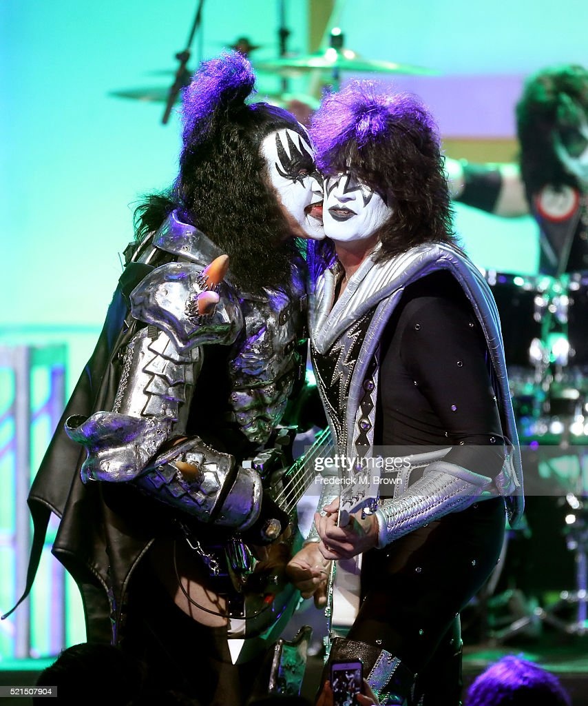 Musicians Gene Simmons (L) and Tommy Thayer of KISS perform onstage during the 23rd Annual Race To Erase MS Gala at The Beverly Hilton Hotel on April 15, 2016 in Beverly Hills, California.