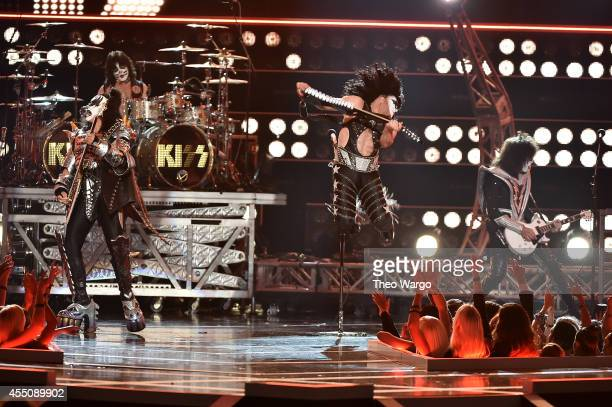 Musicians Gene Simmons Eric Singer Paul Stanley and Tommy Thayer of KISS perform onstage at Fashion Rocks 2014 presented by Three Lions Entertainment...