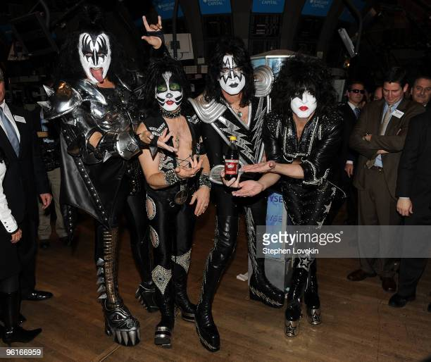 Musicians Gene Simmons Eric Singer Tommy Thayer and Paul Stanley of KISS ring the NYSE closing bell at New York Stock Exchange on January 25 2010 in...