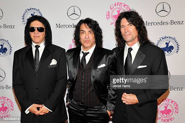 Musicians Gene Simmons Paul Stanley and Tommy Thayer of Kiss arrive at MercedesBenz presents The Carousel Of Hope on October 20 2012 in Los Angeles...