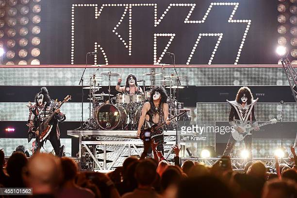 Musicians Gene Simmons Paul Stanley and Tommy Thayer of KISS perform onstage at Fashion Rocks 2014 presented by Three Lions Entertainment at the...