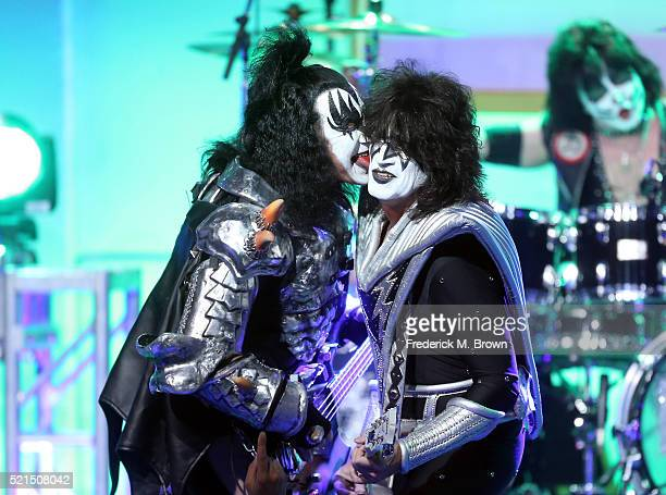 Musicians Gene Simmons Tommy Thayer and Eric Singer of KISS perform onstage during the 23rd Annual Race To Erase MS Gala at The Beverly Hilton Hotel...