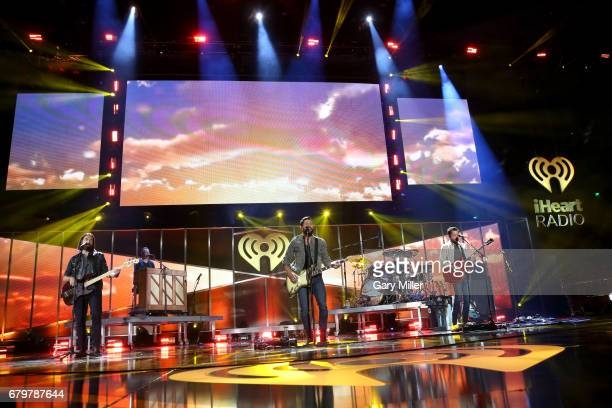 Musicians Geoff Sprung Whit Sellers Matthew Ramsey and Brad Tursi of Old Dominion perform onstage during the 2017 iHeartCountry Festival A Music...