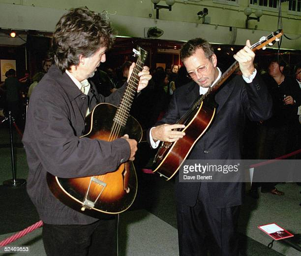 Musicians George Harrison and Eric Clapton play some of the guitars on offer at Christie's Auction on June 24 at Christie's The auction is to raise...